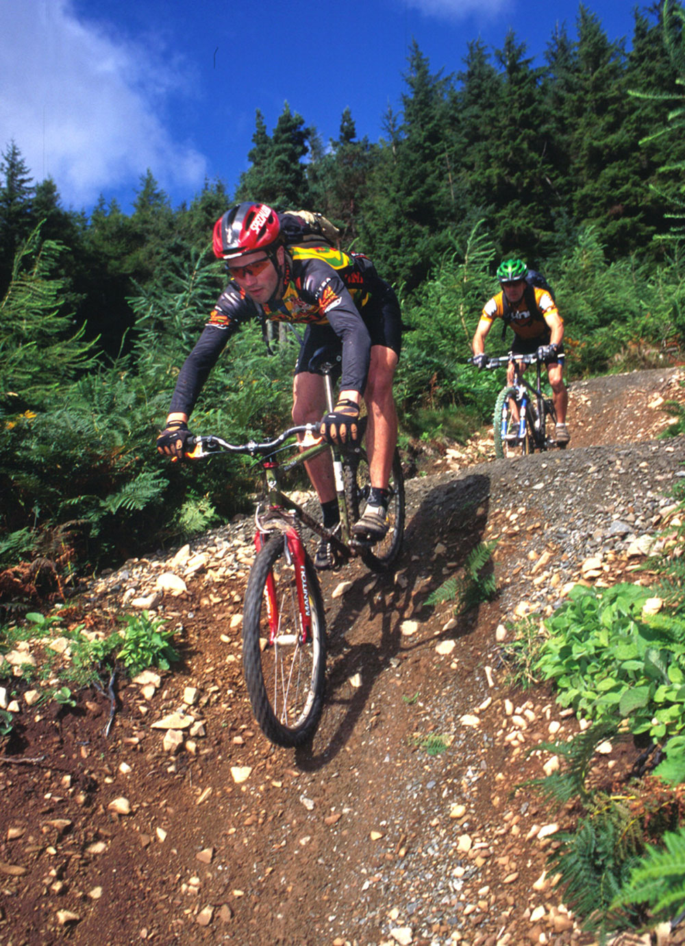 Cue this very old stock FC photo of Chris Duncan riding his V-braked Guyzer frame through the forests.