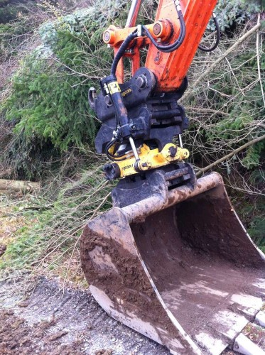 Really big boys toys - rotating digger head for the tricky bits of shaping...