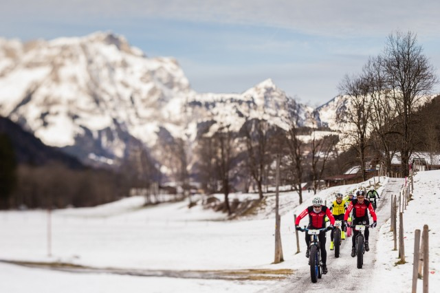 Snow Epic 2015, stage 1, riders group riding through the valley, with Snow Epic ambassador Josef Ajram(number 7) in the pack. Engelberg. Switzerland