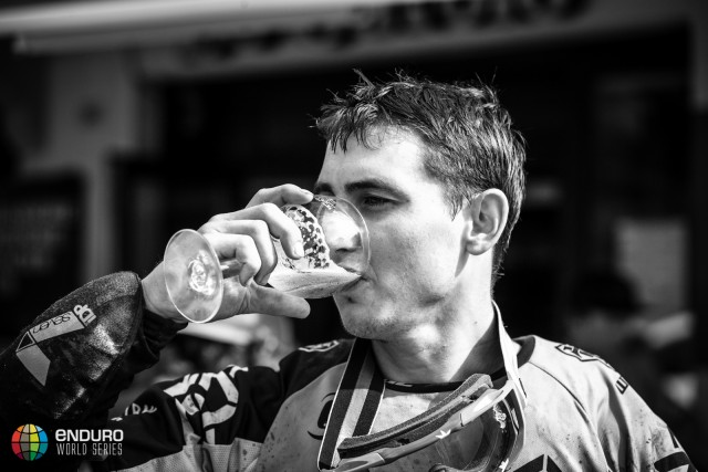 Marco Osborne grabs some post-race refreshment during Enduro World Series round 4, Samoens, France, 2015. Photo by Matt Wragg.