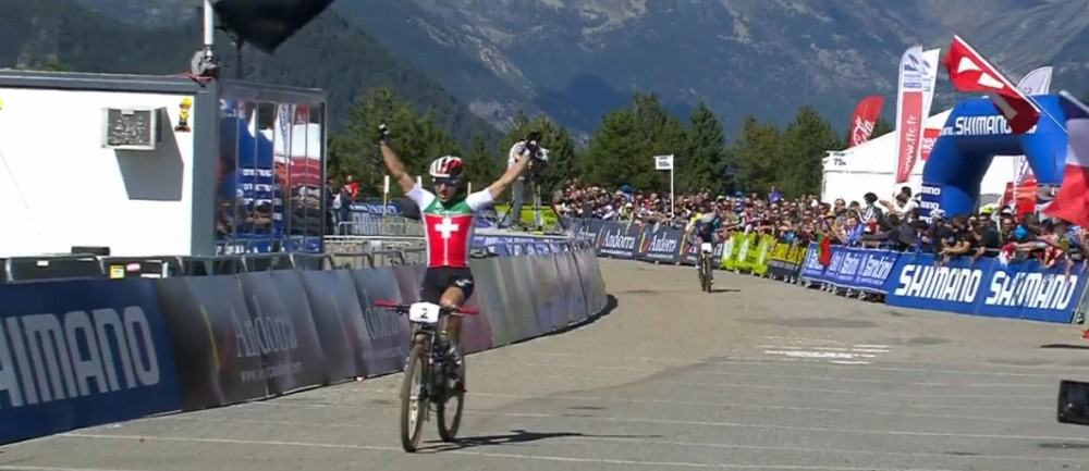 Schurter finishes arms raised