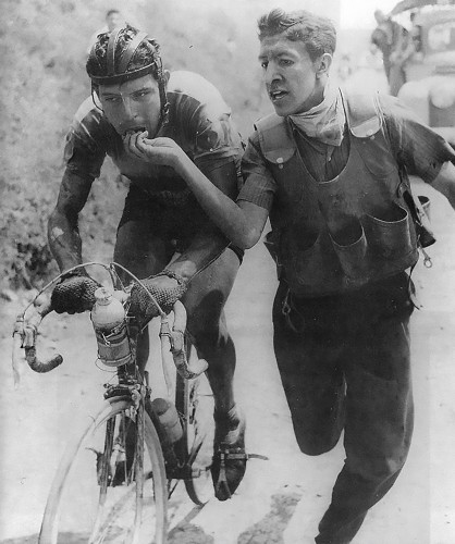 Colombian rider Ricardo Ovalle being fed bocadillo during the Vuelta a Colombia in the early 60's. Photo by Horacio Gil Ochoa