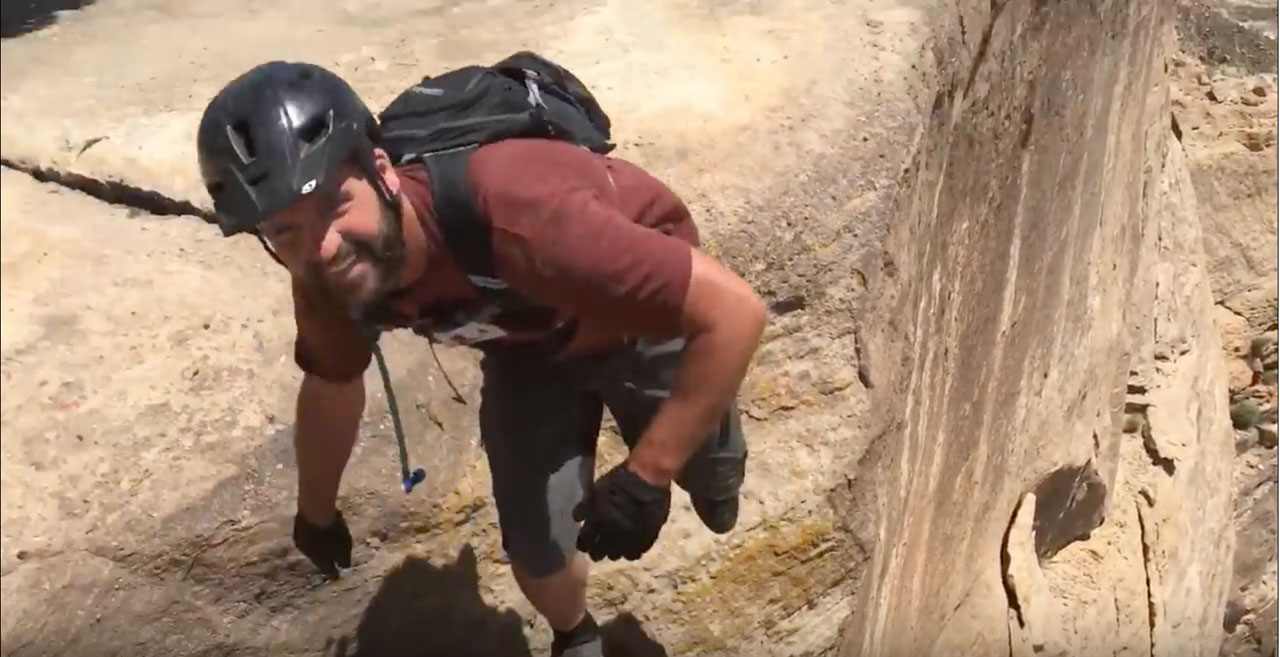 Mountain biker nearly falls off cliff.