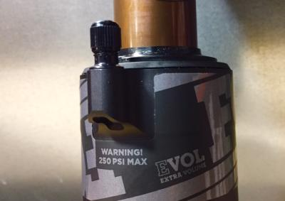 If your shock has this pressure warning then you are OK to keep riding it.
