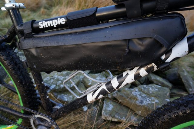 A big old frame bag, at the expense of bottle space