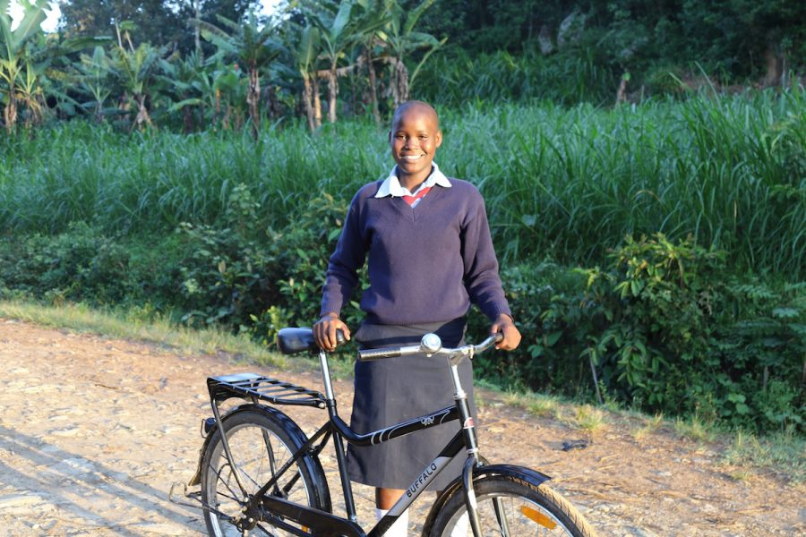 Dianah, a student in Kenya, received a bicycle from World Bicycle Relief in 2015. Before receiving the bike, she was in danger of dropping out of school due to the distance she had to travel and the threat of sexual violence along the way. Now, with her bike, she has been able to stay in school and is studying to become a college professor.