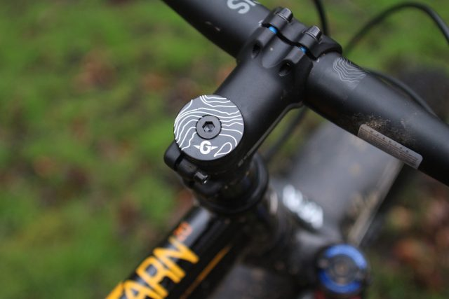 The detail carries through with contour lines graphics on frame, bar and top cap.