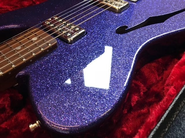 Purple sparkle guitar