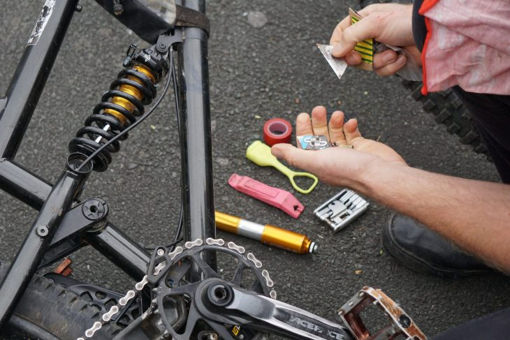 "Rich uses his to carry a few trail essentials such as a single Pink Pedros tyre lever, inner tube, Fabric multi-tool, brass valve adapter for using petrol station pumps, red electrical tape, a BikeSure free Buff, a chain link and a Stanley Blade because ""cutting tiptoes with teeth is well hard""."