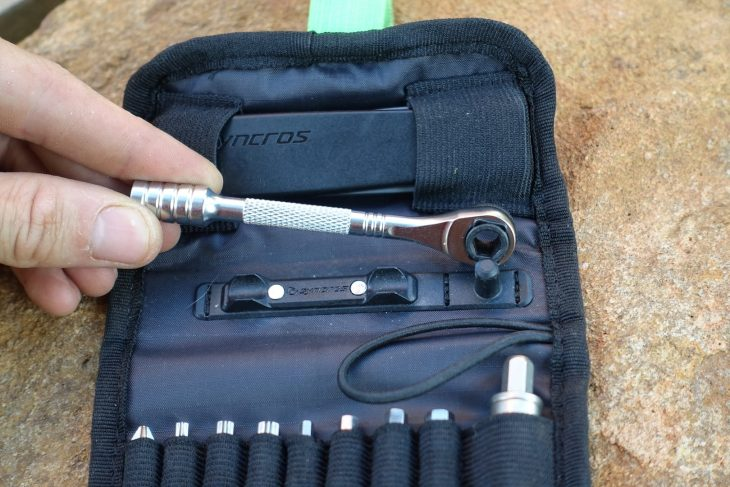 What I Dig About The Syncros Guide Multi-Tool Kit Upon seeing the Syncros Guide Multi-Tool Kit for the first time, I had flashbacks to the Topeak Ratchet Rocket Lite NTX we've previously tested. Indeed it would appear the mini ratchet driver is identical, which is no bad thing. It's got a nice buzz with a 54t engagement ring, and a fiddly black lever switches it into reverse for undoing bolts.