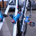 More colour coding happens at the retardation centre - Blue anodised arms on J-Pow's Avid Ultimates. For his European travels Powers uses canti's. All the canti equipped bikes are kept in Holland while the disc brakes stay stateside, to ease logistics